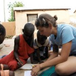 Katherine Alfredo from the University of Texas, Austin, works with students in Ghana while investigating naturally occurring fluoride in groundwater. Photo courtesy of National Engineers Week Foundation (Alexandria, Va.).