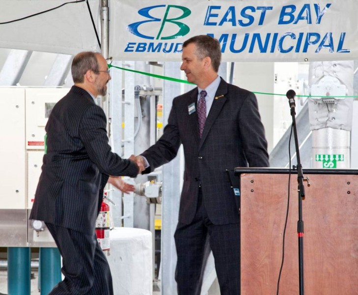 In 2012, Matt Bond (right), WEF past president, congratulates McCormick, then the EBMUD energy program manager, during event unveiling new technology that allowed the district to become an energy-producer. Photo courtesy of EBMUD.