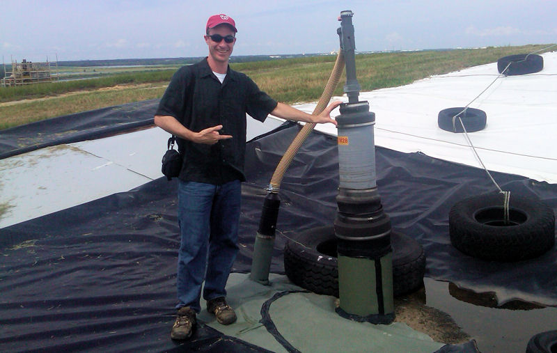 Matt Reis, chief technical officer at the Water Environment Federation (Alexandria, Va.), stands next to a gas extratction device on top of the Polk County (Fla.) bioreactor landfill. Photo courtesy of Reis.