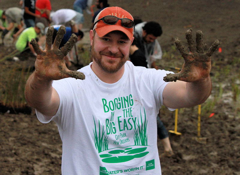 Scott Schaefer, Students and Young Professionals Committee (SYPC) member, sports a Bogging in the Big Easy shirt and muddy hands from participating in the WEFTEC 2012 service project. Photo courtesy of Haley Falconer, SYPC vice chair.