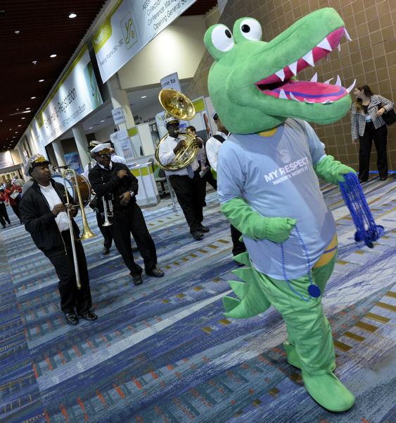 The WEFCom mascot and a New Orleans jazz band leads WEFTEC attendees to the Opening General Session on Oct. 1. Photo courtesy of Oscar Einzig Photography.