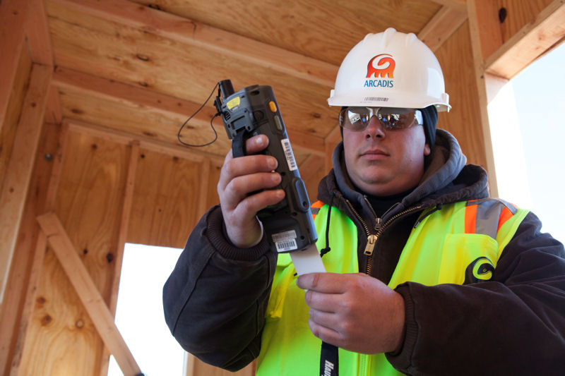 An ARCADIS (Highlands Ranch, Colo.) employee uses the company's HaulPass debris tracking system to assist with restoration efforts after Superstorm Sandy. Photo courtesy of ARCADIS.