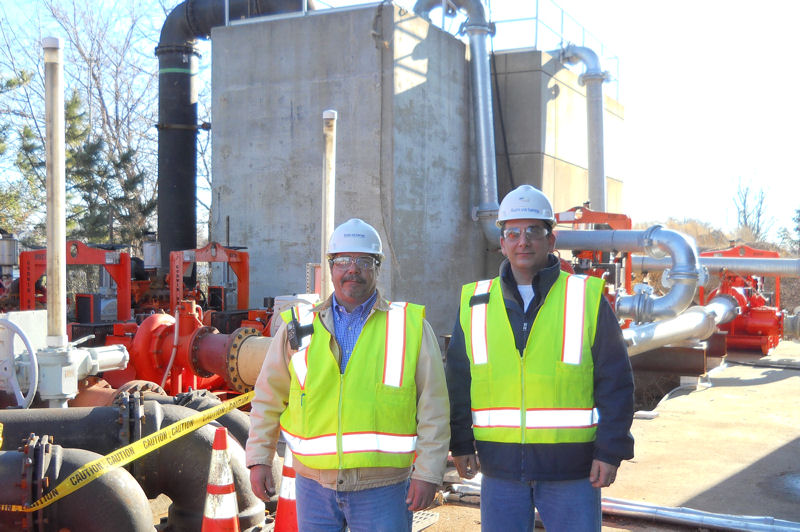 From left, Hazen and Sawyer (New York) employees Robert Pedenzin, construction manager, and Mike DeNicola, program manager, aid in Superstorm Sandy recovery efforts. Photo courtesy of Hazen and Sawyer.