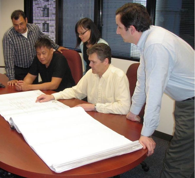 Clark reviews construction drawings with design staff. Photo courtesy of Clark.