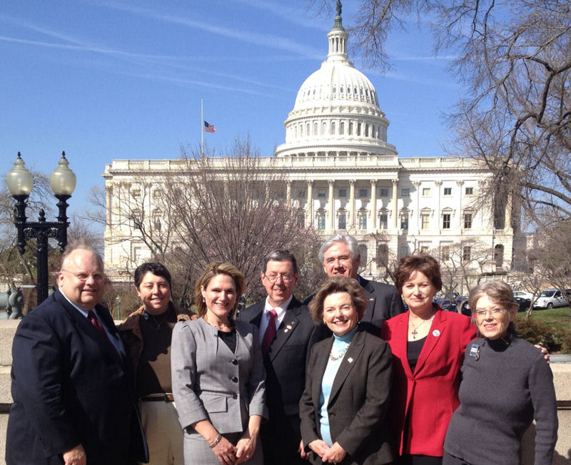 Water Environment Association of (Austin) Texas members, from left, Richard Talley, Mary Gugliuzza, Christianne Castleberry, Charlie Maddox, Mike Howe, Carol Batterton, Glenda Dunn, and Betty Jordan, stand in front of the U.S. Capitol building during their visit to Congress in March 2012. Photo courtesy of Batterton.