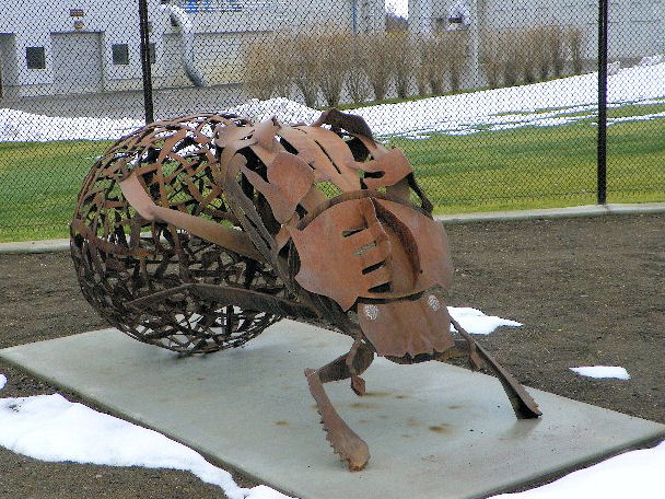 "The facility also installed a lattice-like steel dung-beetle sculpture along the sidewalk named ""A Day at the Office,"" by artists Bill and Karma Simmons. Photo courtesy of the City of Coeur d'Alene Wastewater Utility Department."