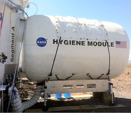 NASA is examining the ability to repurpose ISS cargo transfer bags as backup water recycling and radiation shields, as seen here with these bags lining this space structure. Photo courtesy of Flynn, NASA.