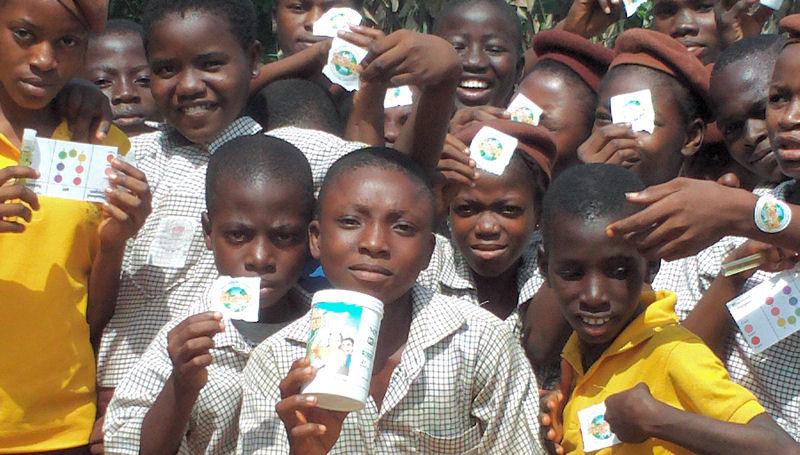 A group of children in Nigeria show off their WWMC supplies. WWMC photo.