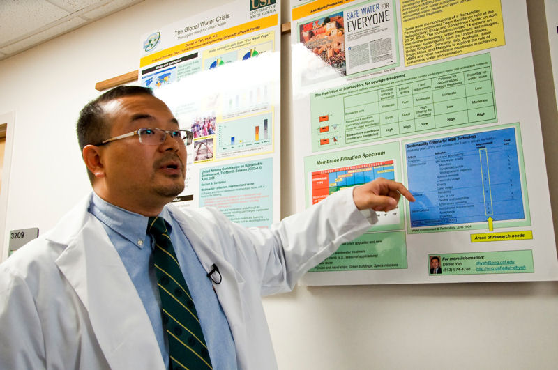Yeh explains how insiration for his research came from WEF's magazine, Water Environment & Technology. An image of the magazine's cover is displayed in his laboratory. Photo courtesy of Blodgett.