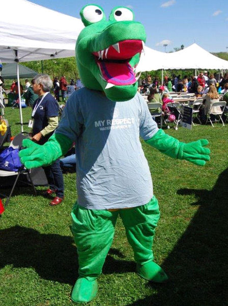 The WEFCOM mascot, Niles the crocodile, made an appearance at Alexandria's earth day event. WEF photo/Grace Hulse.