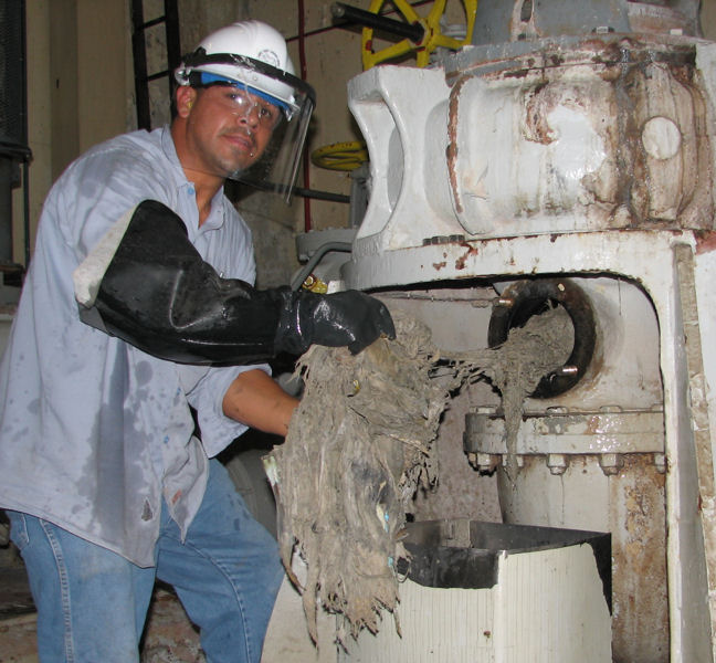 A senior mechanic performs routine dragging in an Orange County Sanitation District lift station pump. Photo courtesy of Ingrid Hellebrand, Orange County Sanitation District.
