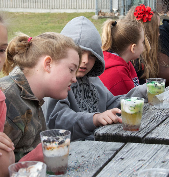 As an educational component of the Long Walk to Water event students learned about groundwater and aquifers from a Florida park ranger. As part of the presentation, students built groundwater filtration systems using ice cream, sprinkles, and gummy bears. Photo courtesy of Weaver.