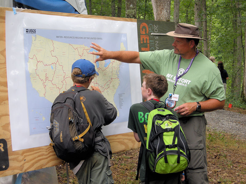 Water Environment Federation (WEF; Alexandria, Va.) volunteer at the 2013 National Scout Jamboree, John Hughes from Infilco-Degremont Technologies (Richmond, Va.) explains the water resource map and shows two Scouts their hometown watersheds. WEF photo/Steve Harrison.