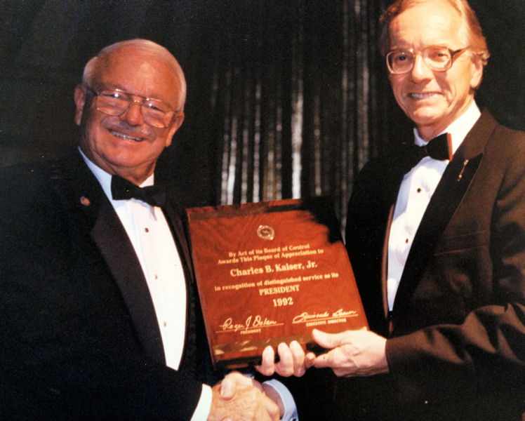 Chuck Kaiser receives a plaque honoring his service as WEF president in 1992. WEF archives photo.