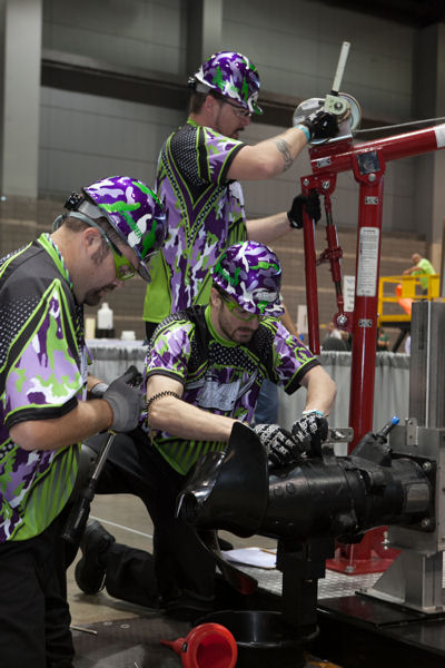 Terminal Velocity team members Stephen Motley, Jason Truitt, and Steve Poe work together during the Wilo Maintence event. Photo courtesy of Kieffer Photography.