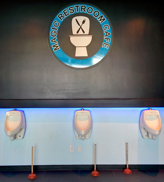The cafe features many restroom-themed decorative pieces including urinals and plungers. Photo courtesy of Chyan.