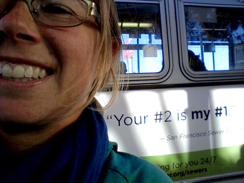 Jessica Arnett took a photo of herself with one of the campaign advertisements on a local bus and shared it on Facebook. Photo courtesy of Arnett.