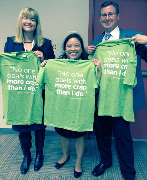 From left, Karen Kubick from the comission, and Christine Radke and Rick Warner both representing the Water Environment Federation (Alexandria, Va.) hold shirts with the campaign's humerous taglines. Photo courtesy of the San Francisco Public Utilities Commission.