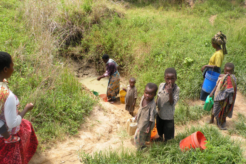 Before the well was constructed women and children walked 10 to 15 miles (16 to 24 km) one way to collect water from depressions in fields. Photo courtesy of Teleios Ministry.