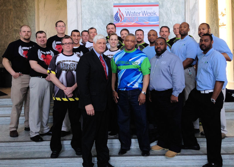 U.S. Rep. Bob Gibbs (R–Ohio) stands with members from three Operations Challenge teams in the Rayburn House Office Building during Water Week 2014. Photo courtesy of Steve Dye, Nexus Government Relations (Washington, D.C.).