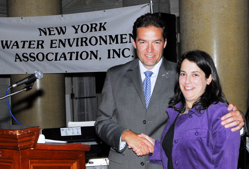 From left, Tom Whetham from NYWEA, presents high school student, Amanda LaValle, with a NYWEA scholarship to pursue an environmental degree in college. Photo courtesy of NYWEA.