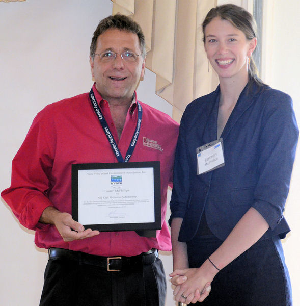 From left, Mark Koester from New York Water Environment Association (NYWEA) presents high school student, Lauren McPhillips, with a NYWEA scholarship to pursue an environmental degree in college. Photo courtesy of NYWEA.