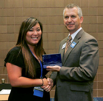 During WEFTEC 2012, Megan Yoo Schneider received a plague from Water Environment Federation (Alexandria, Va.) Matt Bond at the WEF Water Leadership Institute graudation ceremony. Photo courtesy of Oscar Einzig Photography.