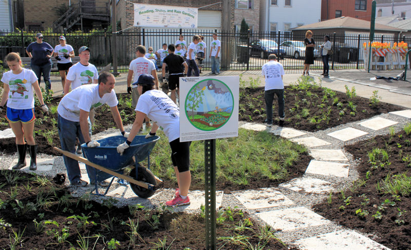 "WEFTEC® 2013 ""Reading, Writing, and Rain Gardens"" volunteers help construct a rain garden in Chicago. Photo courtesy of Falconer"