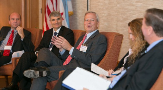 From left, panel speakers Christian Guenner, director of System Development with Hamburg Wasser (Germany); Peter Grevatt, director of EPA's Office of Ground Water and Drinking Water; Ted Henifin, general manager at Hampton Roads Sanitation District (Virginia Beach, Va.); Tali Landau-Ofter, finance director at TaKaDu Ltd. (Yehud, Israel); and moderator David St. Pierre, executive director of the Metropolitan Water Reclamation District of Greater Chicago, participate in a panel at the summit. Photo courtesy of Kieffer Photography.