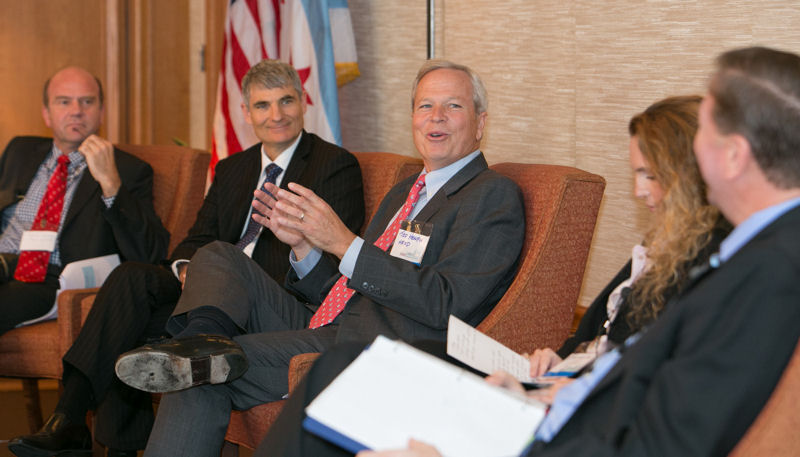 Speakers sit on a panel during the Chicago Water Summit 2014: Global Lessons From Great Water Cities. From left, panelists Christian Guenner, director of System Development with Hamburg Wasser (Germany); Peter Grevatt, director of EPA's Office of Ground Water and Drinking Water; Ted Henifin, general manager at Hampton Roads Sanitation District (Virginia Beach, Va.); Tali Landau-Ofter, finance director at TaKaDu Ltd. (Yehud, Israel); and moderator David St. Pierre, executive director of the Metropolitan Water Reclamation District of Greater Chicago, participate in the summit. Photo courtesy of Kieffer Photography.