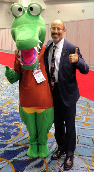 McCormick stands with WEF's Niles the Crocodile during WEFTEC 2014. Photo courtesy of McCormick.