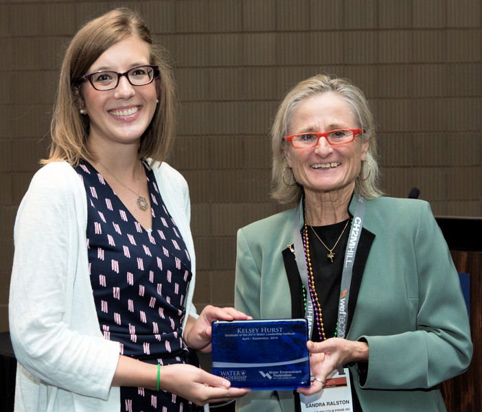 From left, Kelsey Hurst receives her Water Leadership Institute graduation plaque during WEFTEC 2014 from Sandra Ralston, 2013–2014 Water Environment Federation (Alexandria, Va.) president. Photo courtesy of Oscar Einzig Photography.