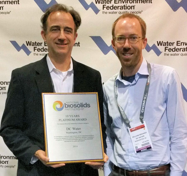 From left, Chris Peot and Bill Brower, both from DC Water (Washington, D.C. ), stand with the 10 Years Platinum Award presented to the organization at WEFTEC 2014. WEF photo/Lisa McFadden.