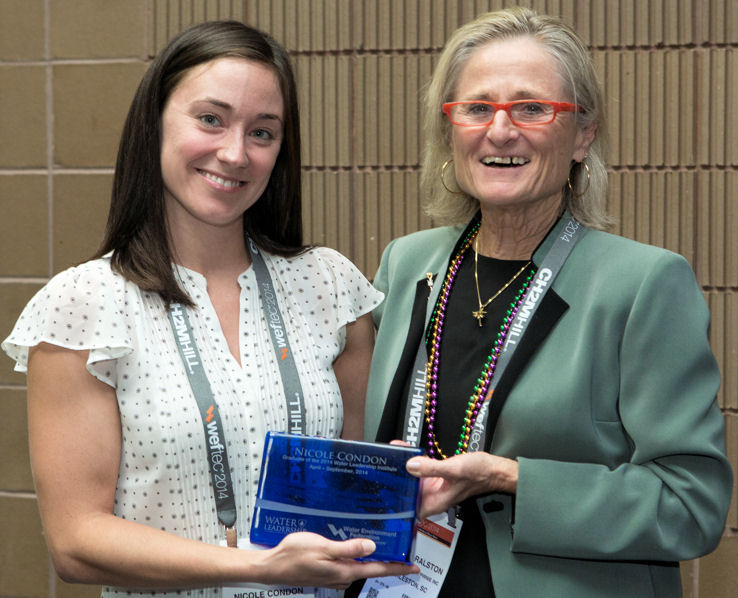 From left, Nicole Condon receives her Water Leadership Institute graduation plaque during WEFTEC 2014 from Sandra Ralston, 2013–2014 Water Environment Federation (Alexandria, Va.) president. Photo courtesy of Oscar Einzig Photography.