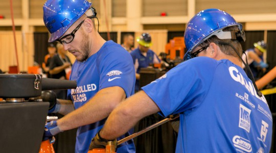 Patrick Ross and Kevin Ganley, members of the Water Environment Association of South Carolina team Controlled Chaos, compete during Operations Challenge 2014. Photo courtesy of Kieffer Photography.