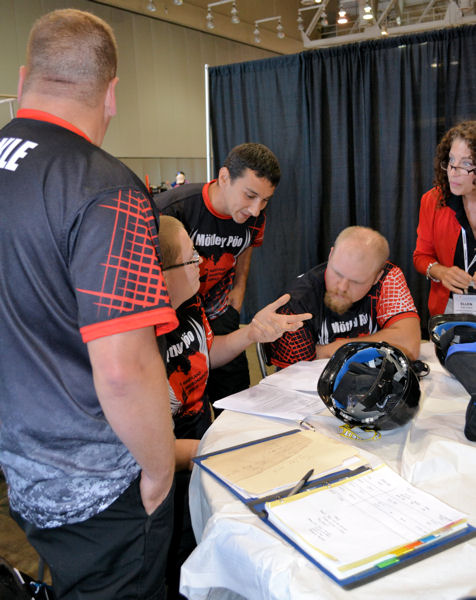 From left, Yeakle, Boulden, Myers, Rumbaugh, and Frketic review test scores during the Tri-Association Conference Operations Challenge Event. Photo courtesy of Frketic.