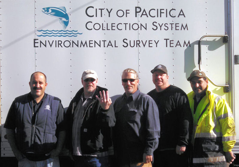 Wastewater treatment maintenance workers for the city of Pacifica, Calif., retrieved a $1000 gold ring for resident Lary Warren, who had accidentally flushed it down the toilet. From left to right, Maintenance Worker Doug Trade, resident Lary Warren, Collection System Manager Brian Martinez, Maintenance Worker Mike Williams, and Maintenance Worker Eddy Pastrano. Photo courtesy of City of Pacifica, Calif.