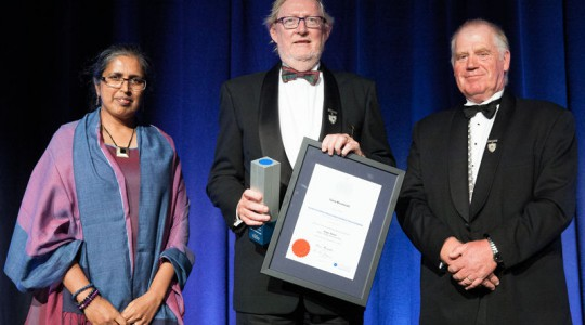 Garry Macdonald (center) received the 2015 Angus Award for Water, Waste, and Amenities from Kevin Thompson (right), the 2014–2015 president of the Institution of Professional Engineers New Zealand (IPENZ; Wellington); and Sulo Shanmuganathan (left), Opus International Consultants Ltd. (Wellington) award sponsor representative. Photo courtesy of Institution of Professional Engineers New Zealand (Wellington).