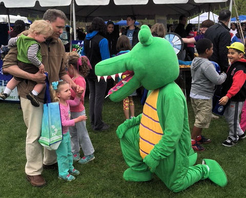 WEFCOM mascot Niles the Crocodile visits children during the Alexandria, Va., Earth Day event. Water Environment Federation (WEF; Alexandria) photo/Kelsey Hurst.