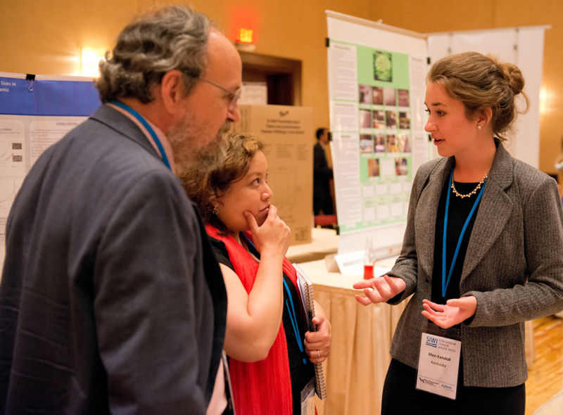 From left, U.S. SJWP judges Glenn Harvey and Christine Radke listen to Ellen Kendall, student contestant from Kentucky talk about her research. Photo courtesy of AOB Photo.