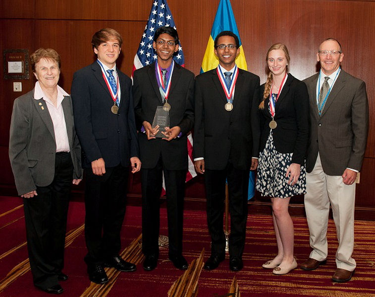 Jeanette Brown (left), chair of U.S. SJWP judges and past president of the Water Environment Federation (Alexandria, Va.) and Tom Sage (right), representative from competition sponsor Xylem (Rye Brook, N.Y.) stands with 2015 U.S. SJWP winners (from left) including runner-up Jack Andraka from Maryland, winner Alagappan, runner-up Bluyé DeMessie from Ohio, and Bjorn von Euler Innovation in Water winner Natalie Bush from Louisiana. Photo courtesy of AOB Photo.