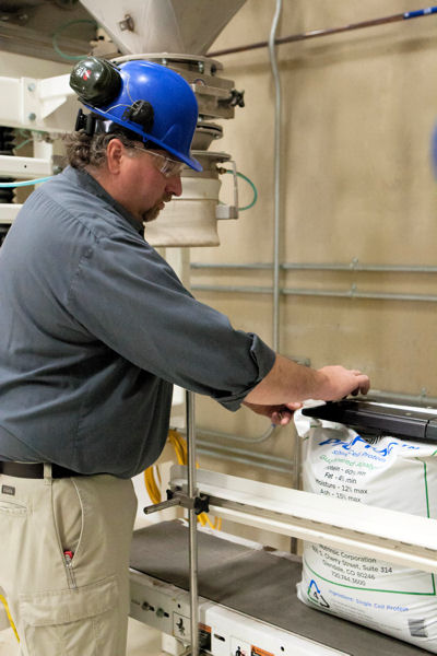 A Nutrinsic employee packages the final protein product, ProFloc, developed at the brewery.  Photo courtesy of Nutrinsic Corp.