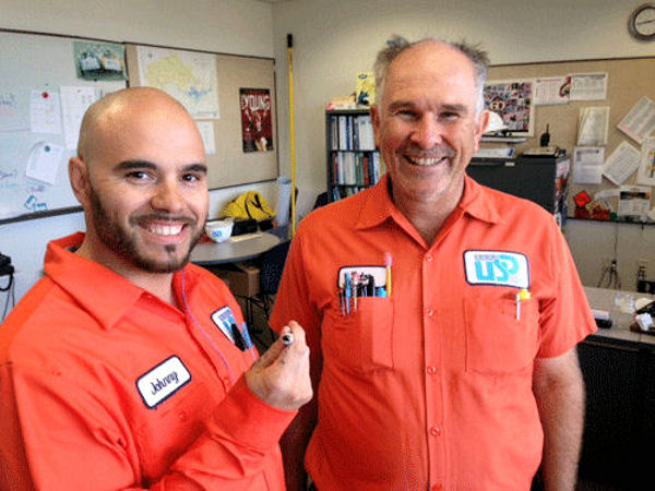 From left, Union Sanitary District (Union City, Calif.) employees Johnny Powell and Victor Vasut show off the ring they rescued. Photo courtesy of Shawn Nesgis, Union Sanitary District.