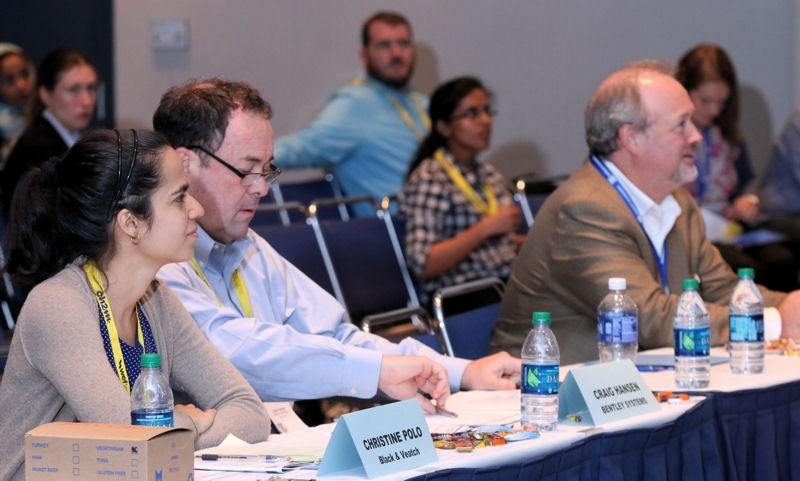A panel of judges and WEFTEC 2015 attendees listen to student teams present their engineering solutions at the Student Design Competition. Photo courtesy of Oscar & Associates.