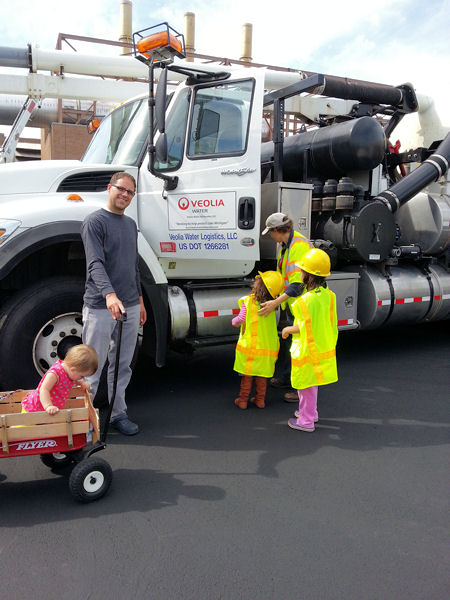Jones Island Water Reclamation Facility visitors often include children who are eager to see what happens at a water resource recovery facility and enjoy examining the trucks and playing in chalk-art areas. Photo courtesy of Veolia.