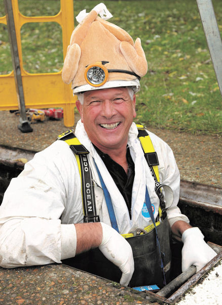 "Rob Smith, the Sewermen's ""chief flusher,"" uses humor to promote citizen awareness of the problems that turkey grease causes on the sewer system pipes. Photo courtesy of Thames Water."