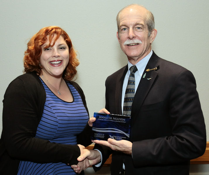 From left, Jennifer Fulcher receives her Water Leadership Institute graduation plaque during WEFTEC 2015 from Paul Bowen, 2015–2016 Water Environment Federation (Alexandria, Va.) president. Photo courtesy of Oscar & Associates.