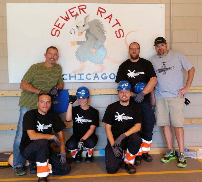 Past competitors Donnie Cagle (left) and Stephen Motley (right) pose with DWA Team Düsseldorf members Ulli Horst Winkler, Maren Scholten, Hans-Joachim Ziethen, and Tobias Hasselhoff during a special practice session hosted by the Illinois Water Environment Association team, the Sewer Rats. Photo courtesy of Heidebrecht.