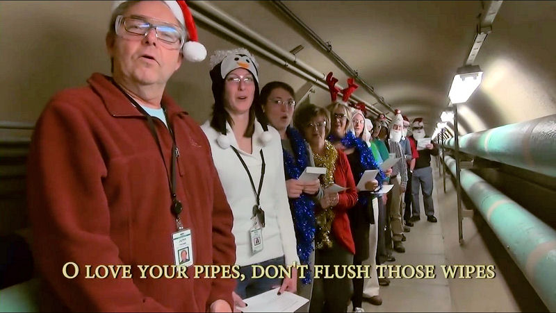 "Staff at NEW Water, the brand of the Green Bay (Wis.) Metropolitan Sewerage District, sing ""O Love Your Pipes"" in a community education video to relay the importance of not flushing wipes or putting grease down the drain. Photo courtesy of Green Bay Metropolitan Sewerage District."