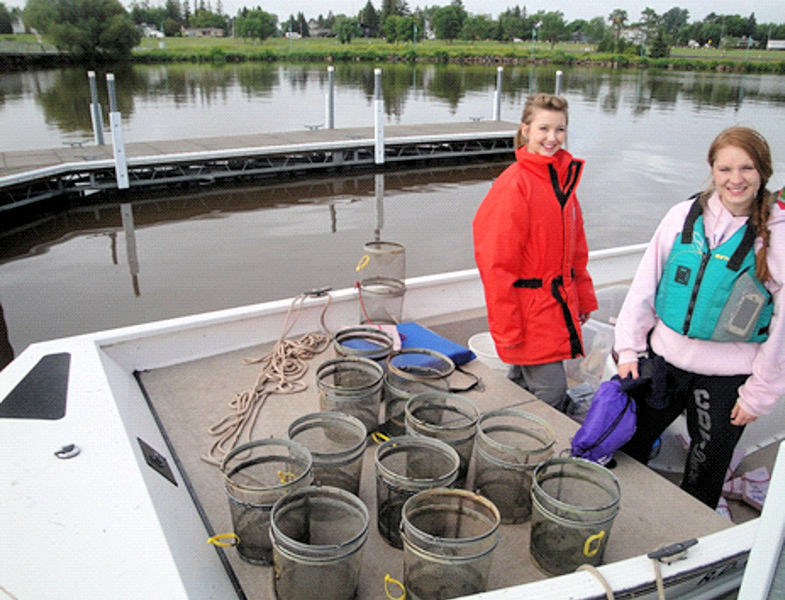Christine Neumann and Crystal Moynan, 2014 Minnesota SJWP winners, sample an invasive benthic fish known as Round Gobies on Lake Superior. Photo courtesy of Welsh.